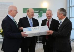Barry O'Leary, chief executive IDA, Minister Michael Noonan, Barry O'Sullivan, Vistakon Ireland plant manager and Minister Richard Bruton