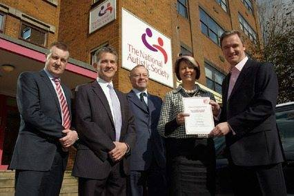 Nua Healthcare stands out in autism provision accreditation Noel Dunne and Liz O' Neill of Nua Healthcare with National Autistic Society UK CEO Mark Lever and director of Autism Accreditation Robert Pritchett